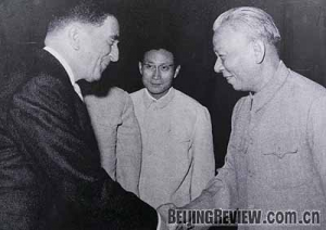 Lucien Paye (left), the first French Ambassador to China, presents his credentials to Chinese President Liu Shaoqi (right) on May 31, 1964