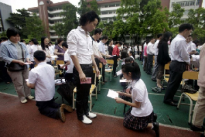 kneeling, a time-honored Chinese method of discipline