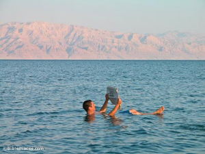 reading paper in dead sea