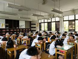 After lunch, it is customary for Taiwan students to take a nap on their desks.
