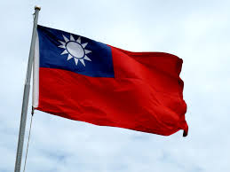 The flag of the Republic of China on Taiwan: Azure Sky, White Sun, and Red Over the Earth