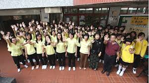 A more recent image of the lemon yellow shirts of the second best girls high school in Taipei. In 1970, only pleated skirts, not pants, were allowed. Hair was uniformly cut at ear lobe length.
