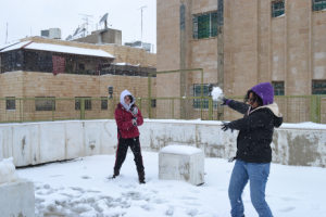 I found this recent picture online. It looks like rooftop snowball fights have survived till today in Amman!